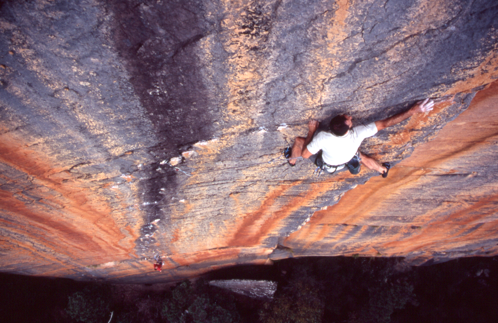 "Athol putting the finishing touches on ""Archimedes' Principle"" (25), Eureka Wall, 2004. Rob Lindblade on belay."