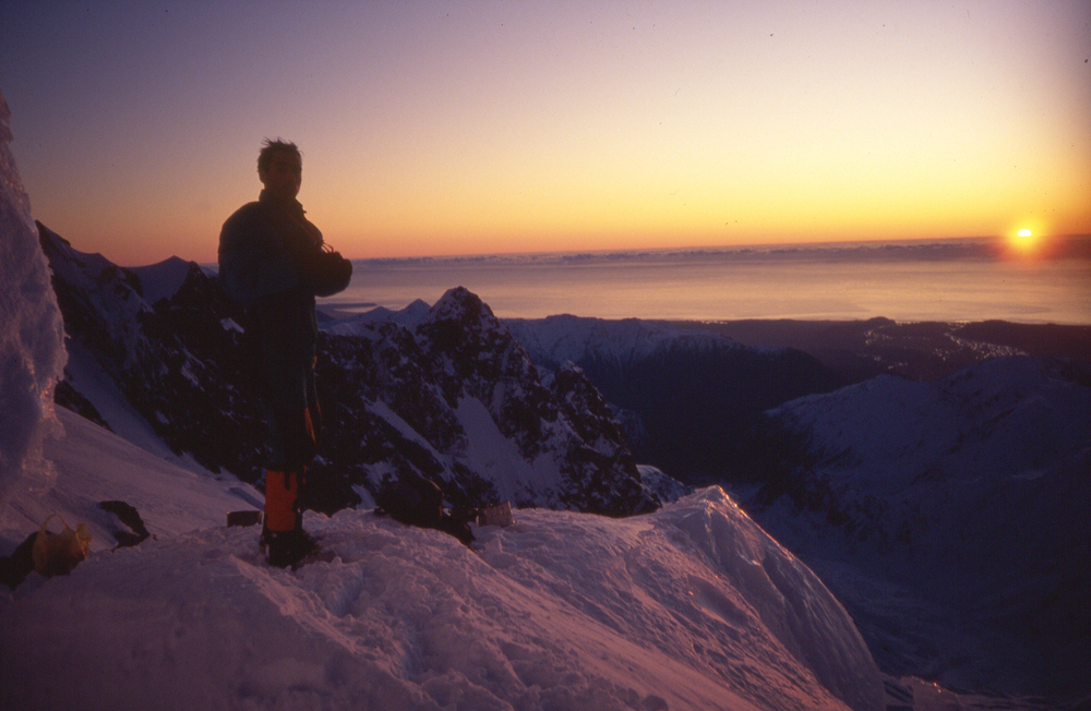 Bivy site in the Balfour neve with the west coast and Tasman ocean beyond, winter 1993.