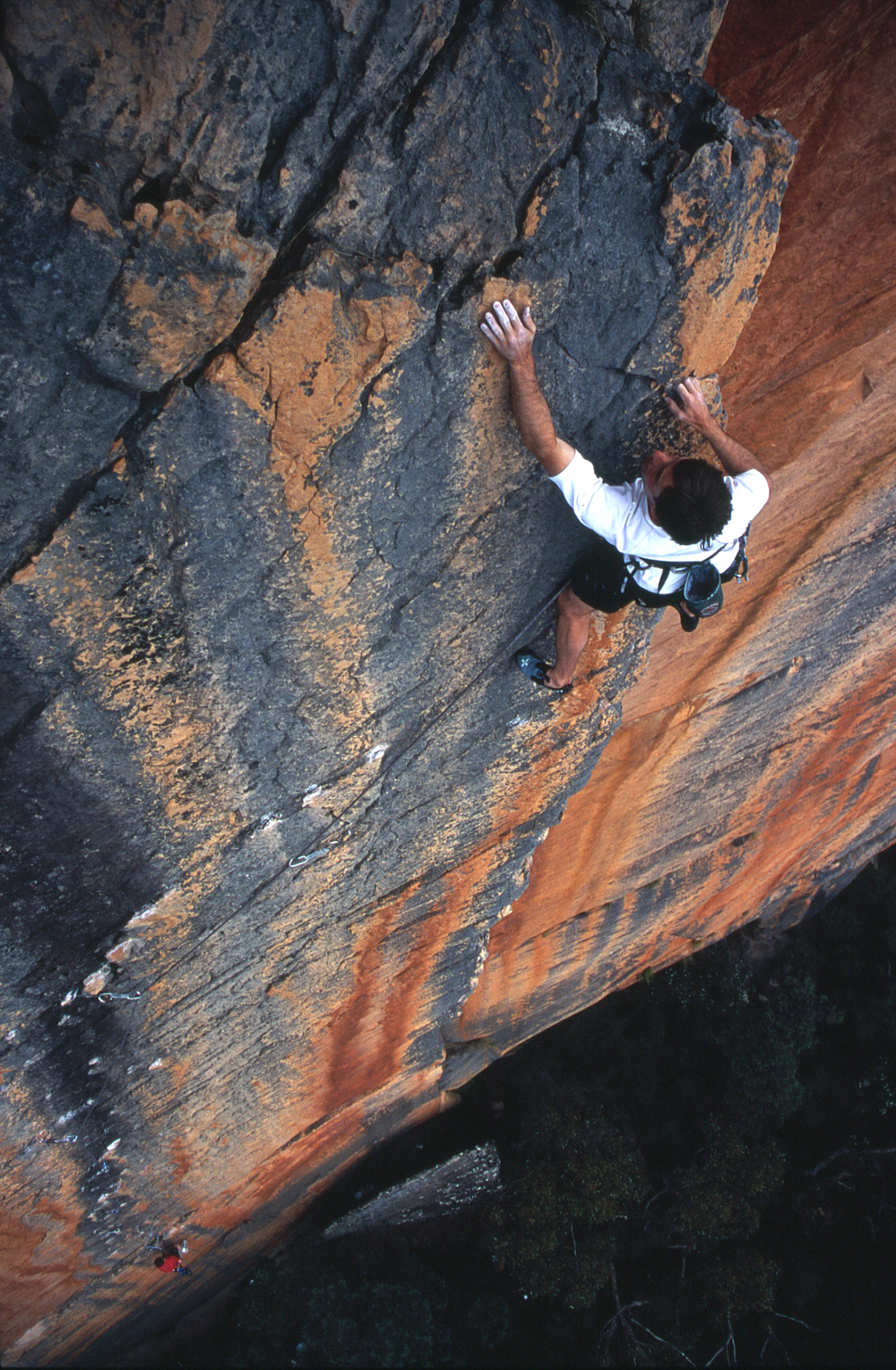 "At the top of the first pitch of ""Archimedes' Principle"" (25), Eureka Wall, Grampians, 2004. Photo: Athol Whimp."