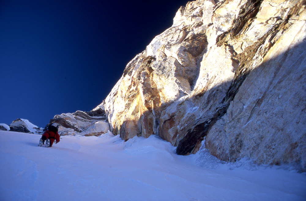 Athol moving fast and unroped at dawn, about to reach the summit ridge, ca. 7250m.