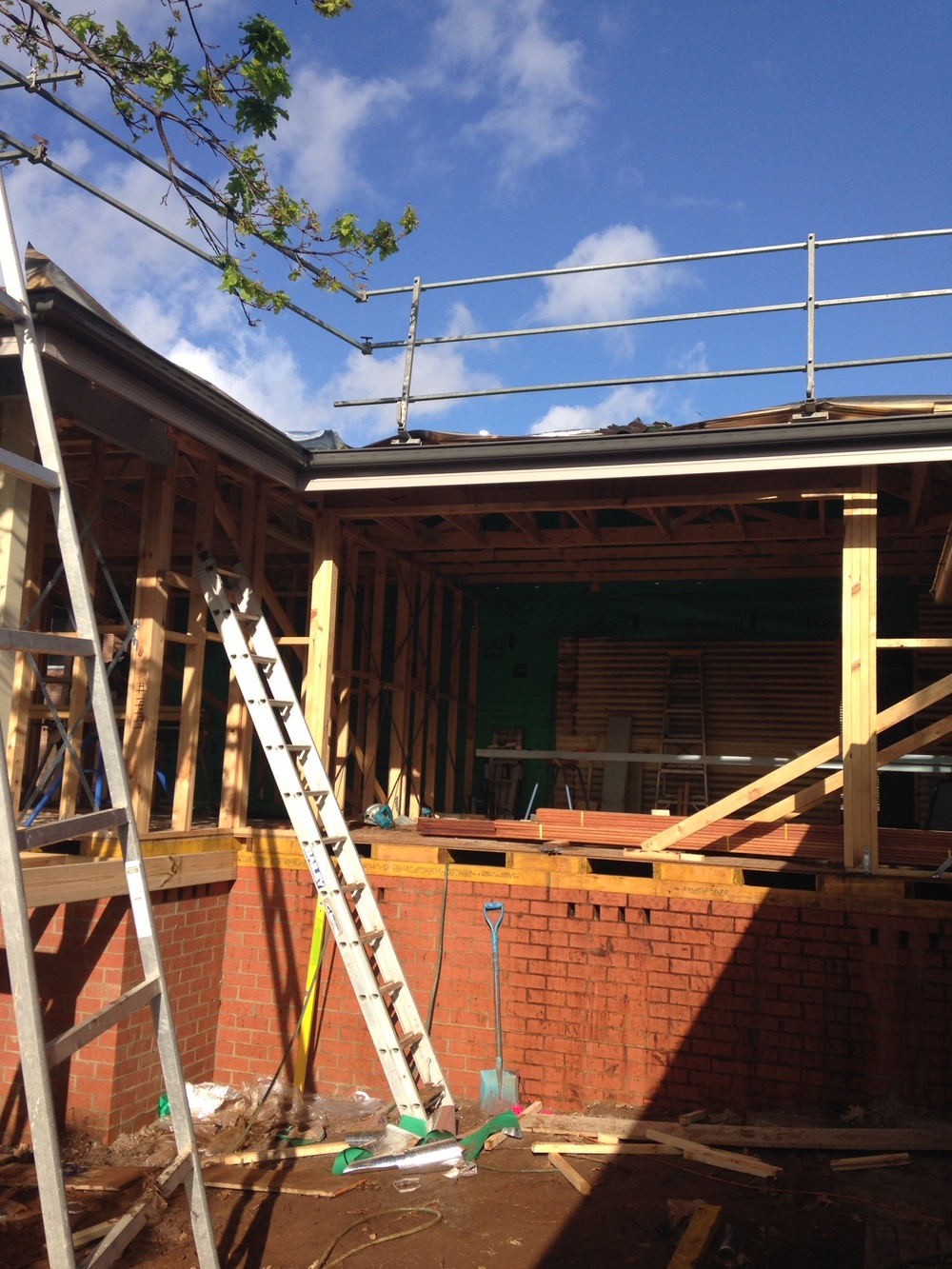 Roof trusses up and new tiles on