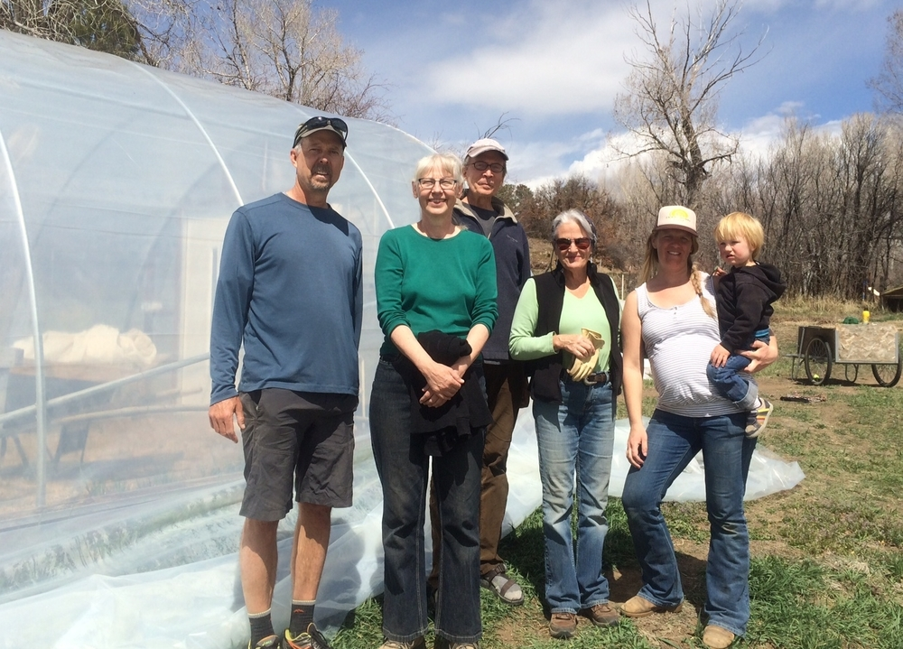 A group helped put up the Jensen's greenhouse.