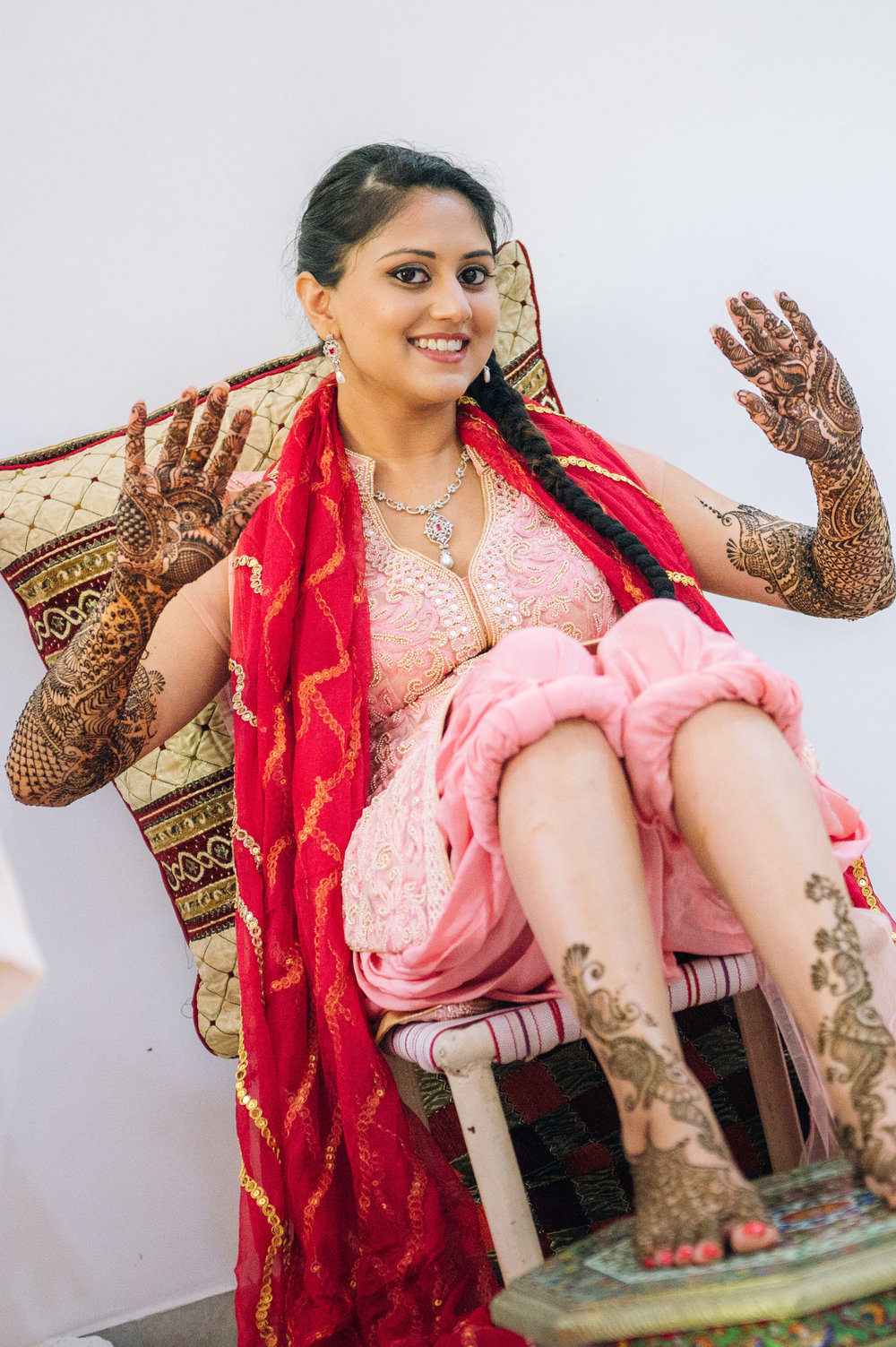 Check out those striking designs! Did you know that in order not to smudge the fresh henna, the bride-to-be must not move. She would need people to feed her water and even scratch her nose.