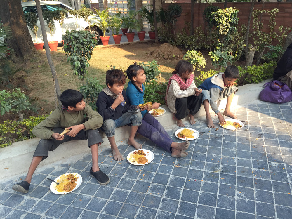 Underprivileged kids given hot food to eat. (Image taken with iPhone 6+)