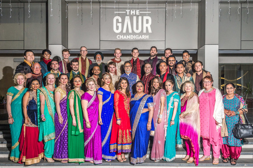 The international contingent of guests who flew into India for this wedding. Just look at how beautifully the ladies are in their lehenga, ghagra cholis, salwar kameez and saris while the gentlemen are clad in their kurta pyjamas as well as sherwanis.