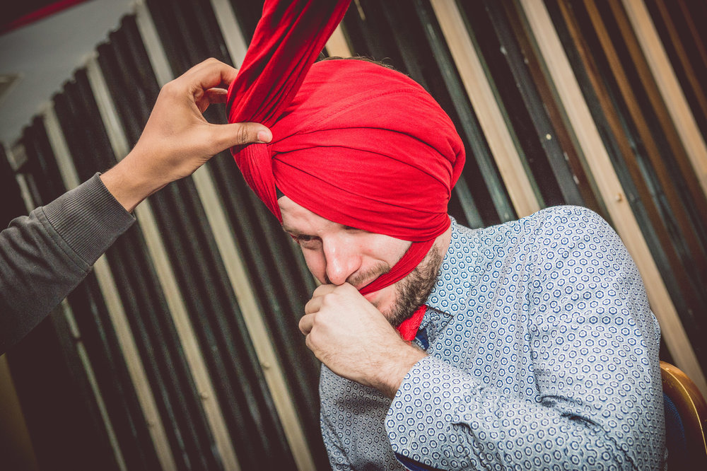 Sporting guests even agreed to put on the turban to attend this traditional Sikh wedding.