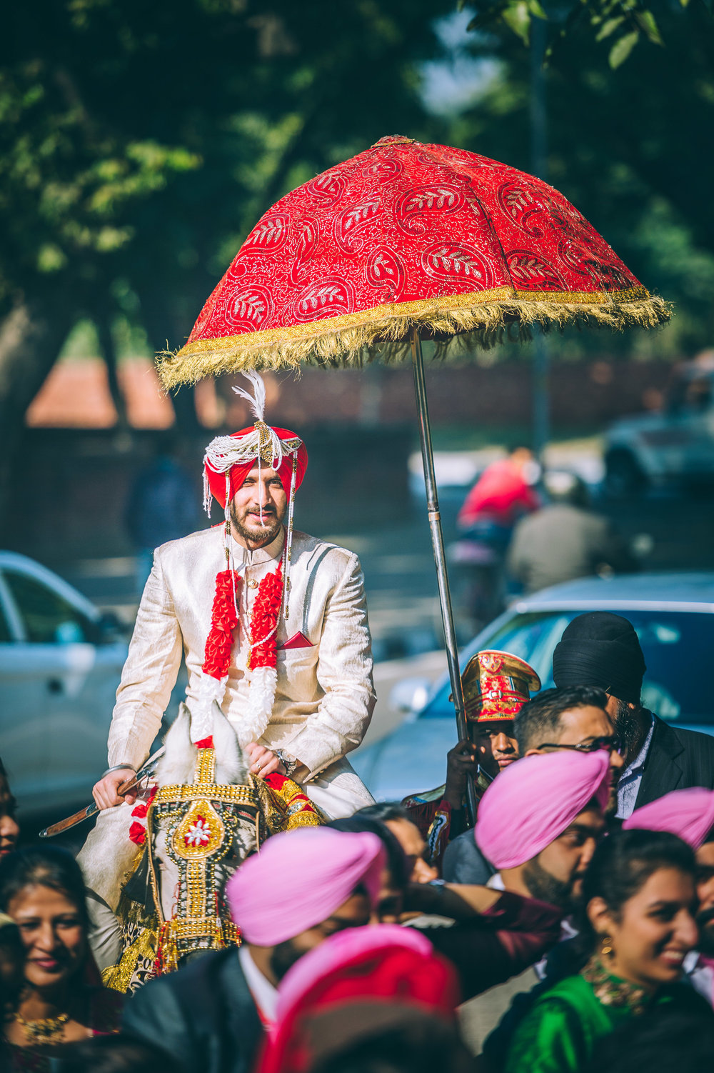 Doesn't this groom look like a knight in shining armour (without the shield but with his Kirpan) riding his pristine white horse?