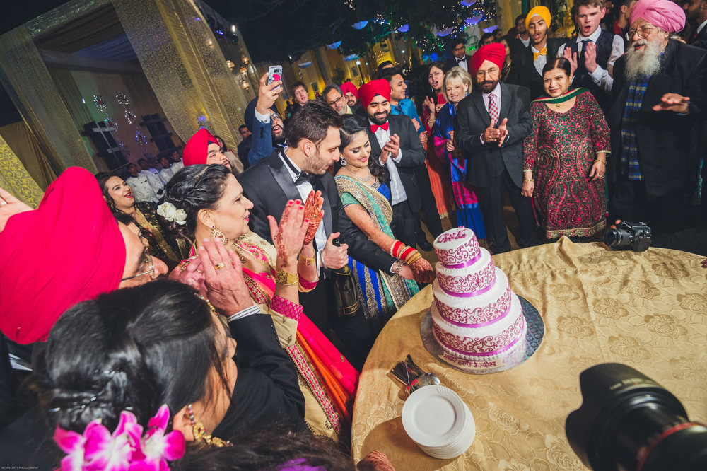 Cake cutting for the couple during the wedding reception.