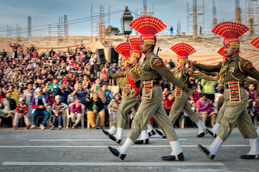 After the battle cry, these stone-faced guards marched down the road towards the Pakistani border. They then began to display a series of synchronized stomps, high kicks, aggressive body jerks and headgear adjustments along with their serious expressions - all to intimidate the opponents.