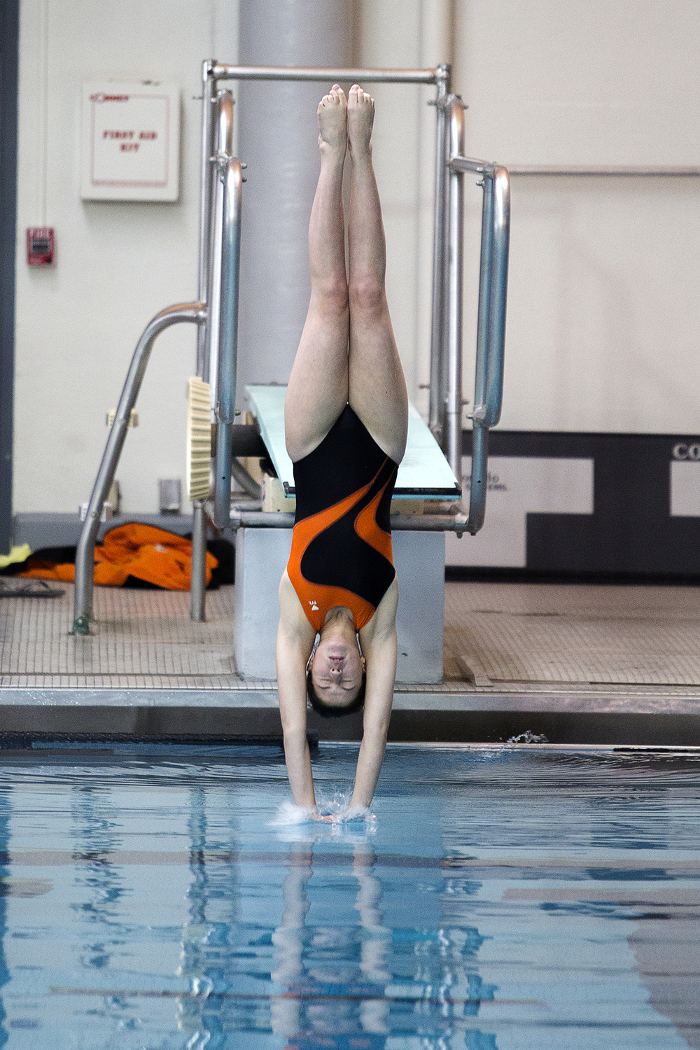 Nicole Lohn of Jackson dives in the Class 3A girls state swim and dive championship preliminary round Thursday at the Campbell County School District Aquatic Center. Lohn was one of 4 Jackson divers to place in the top 6 in the semi-finals.