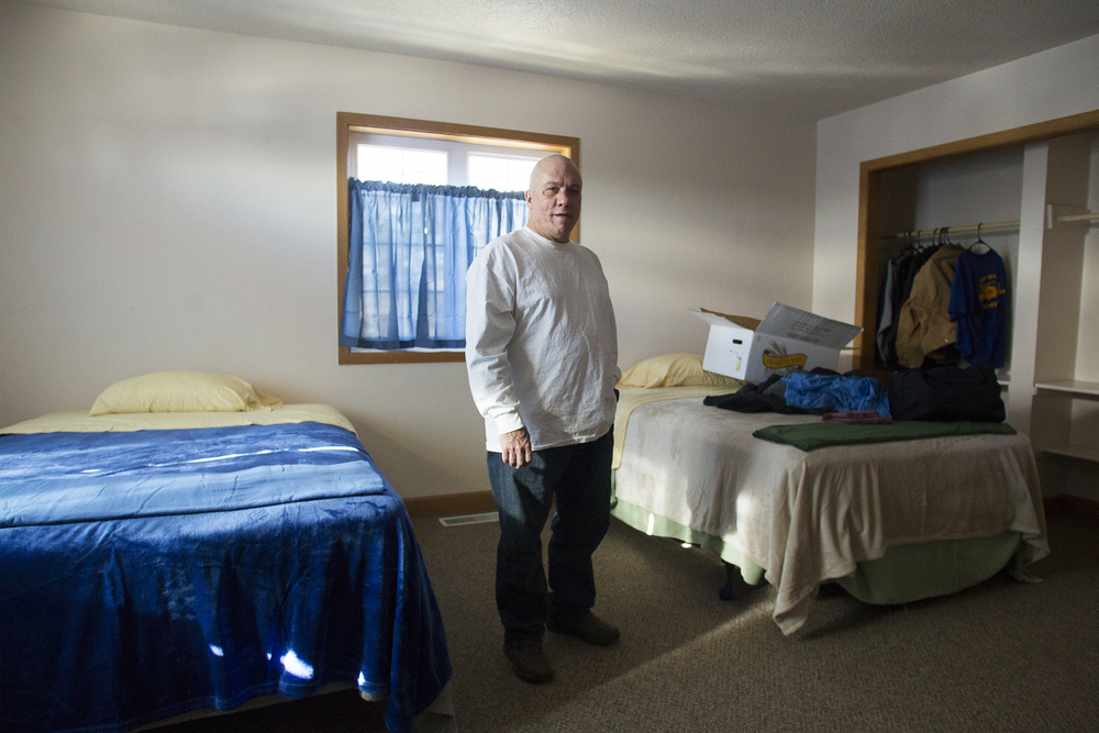 "Thayne Arnoldi stands in his bedroom at Second Chance Ministries on Wednesday morning. Arnoldi is the first resident to move into the organization's new 11-bed living space. Deputy Director Jeannie Miller says housing is one of the biggest keys to success for folks returning from incarceration, and ""to be able to finally meet (that need) is huge."""