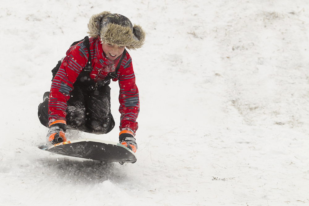 Johnathan Peel, 10, catches air while sledding Saturday at Sage Valley Junior High.