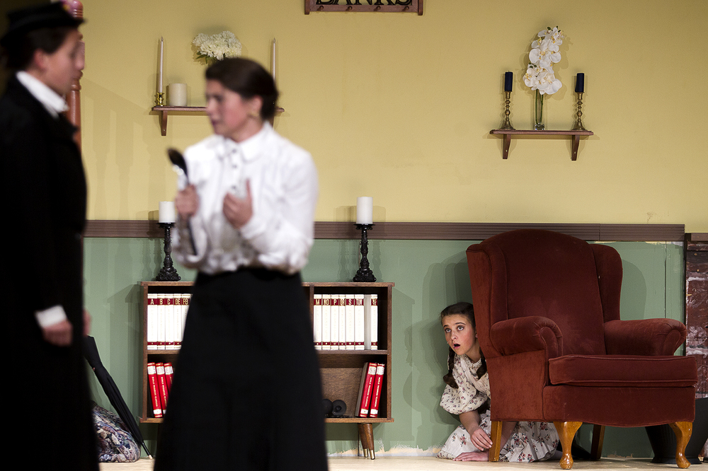 Misteen English, right, playing Jane Banks watches Anna Capron, center, and AnneMarie Gutierrez, Miss Andrew and Marry Poppins, during the final rehearsal for Campbell County High School's production of Mary Poppins, which opens Thursday night.
