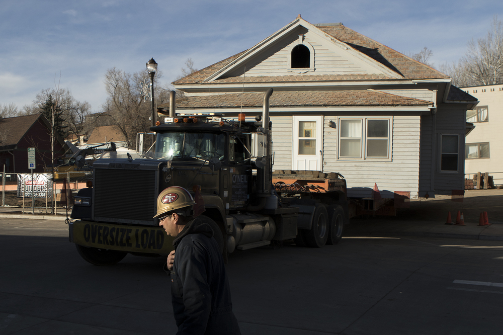 Mario Coppe of O'Neil Company directs the truck carrying the 100-year-old house that sat at 604 S. Gillette Ave. onto the road Thursday morning as the truck makes its way to its final home adjacent to the Heppner Ranch north of Rozet. Just before the house was set to be demolished, Mike Cote contacted owner Christie Williams and offered to move it to his ranch, where he will restore it to it's original condition.