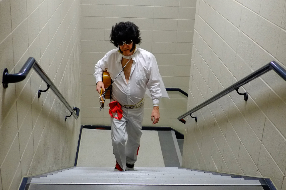 Jim Berman, dressed as Elvis, walks up the stairs at the Heritage Center Theater Saturday evening after playing a song in the Gillette's Got Talent competition.