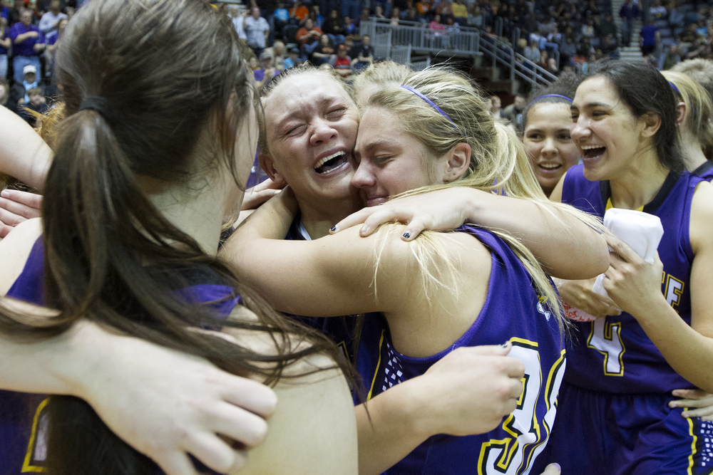 Gillette seniors Lauren Hallcroft and Jessie Geer hug after winning the 4A state basketball title, beating Natrona County 84-62, Saturday afternoon at the Casper Events Center in Casper.
