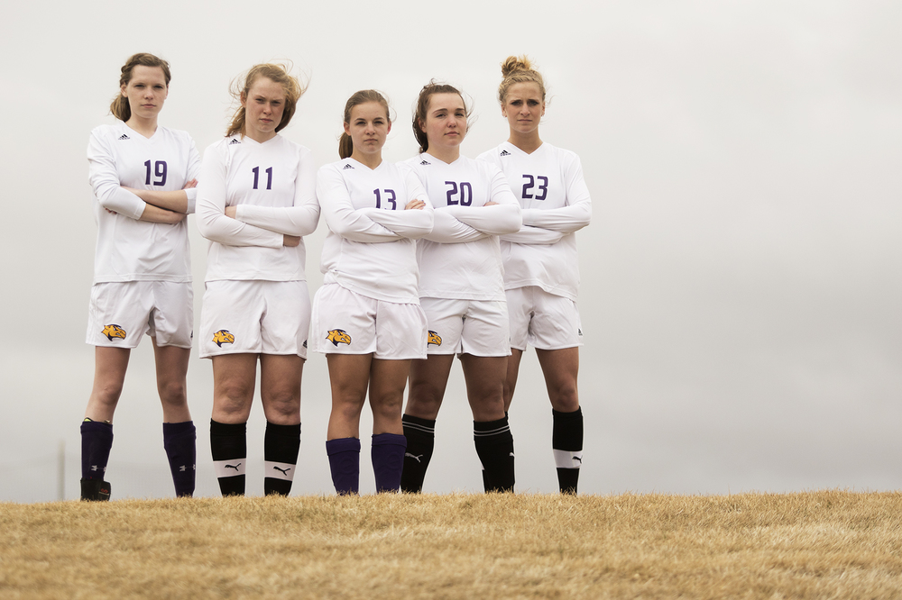 Girls soccer players Hailey Jensen, from left, Sonya Crone, Kenisha Melanson, Ashley Wilcox and Emma Jurewicz, all seniors, prepare for their final season as Camels Tuesday at CCHS South Campus.
