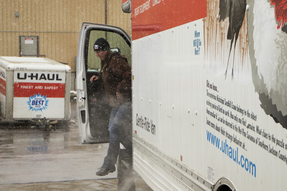"Heidi Buen gets out of a U-Haul truck after getting it ready for a customer Friday afternoon on the lot at KP Management where she works. The lost is mostly empty these days as the trucks are hard to come by everywhere from Billings to Rapid City. ""The whole region is wiped out,"" said KP Management owner Kristene Partlow, ""There's way more demand than supply."""