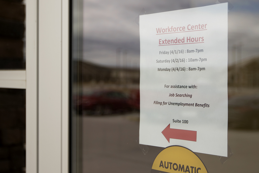 A note on the door of Wyoming Department of Workforce Services alerts clients to the office's extended hours on Friday April 1, 2016. After more than 450 local mine workers were laid off, state and local agencies worked extra to get them help, including setting up a temporary resource center at Gillette College.