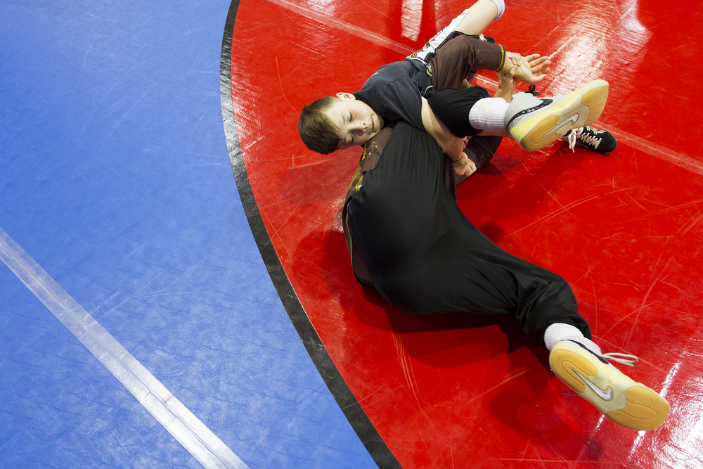Peak Wrestling's Seamus Casey wrestles University of Wyoming wrestler Bryce Meredith during a workshop at Sage Valley Junior High Saturday afternoon. Meredith is the first wrestler from Wyoming to go to the NCAA Final, held this year at Madison Square Garden in New York City.