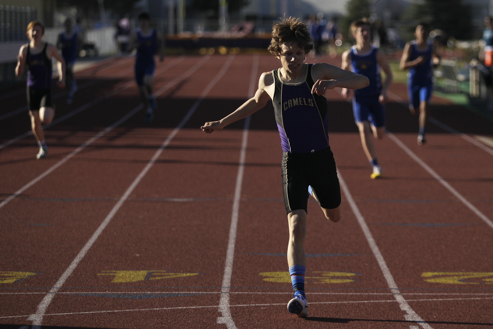 John Bozovich crosses the finish line in the first heat of the boys 400-meter dash Tuesday afternoon during the Camel-Bronc Dual at CCHS North Campus.