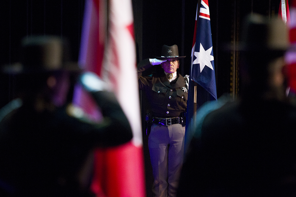 Campbell County Sheriff Detention Officer Penny Hottell salutes following the national anthem Saturday night before the queens modeling and speeches portion of the National High School Finals Rodeo at the Heritage Center Theater.