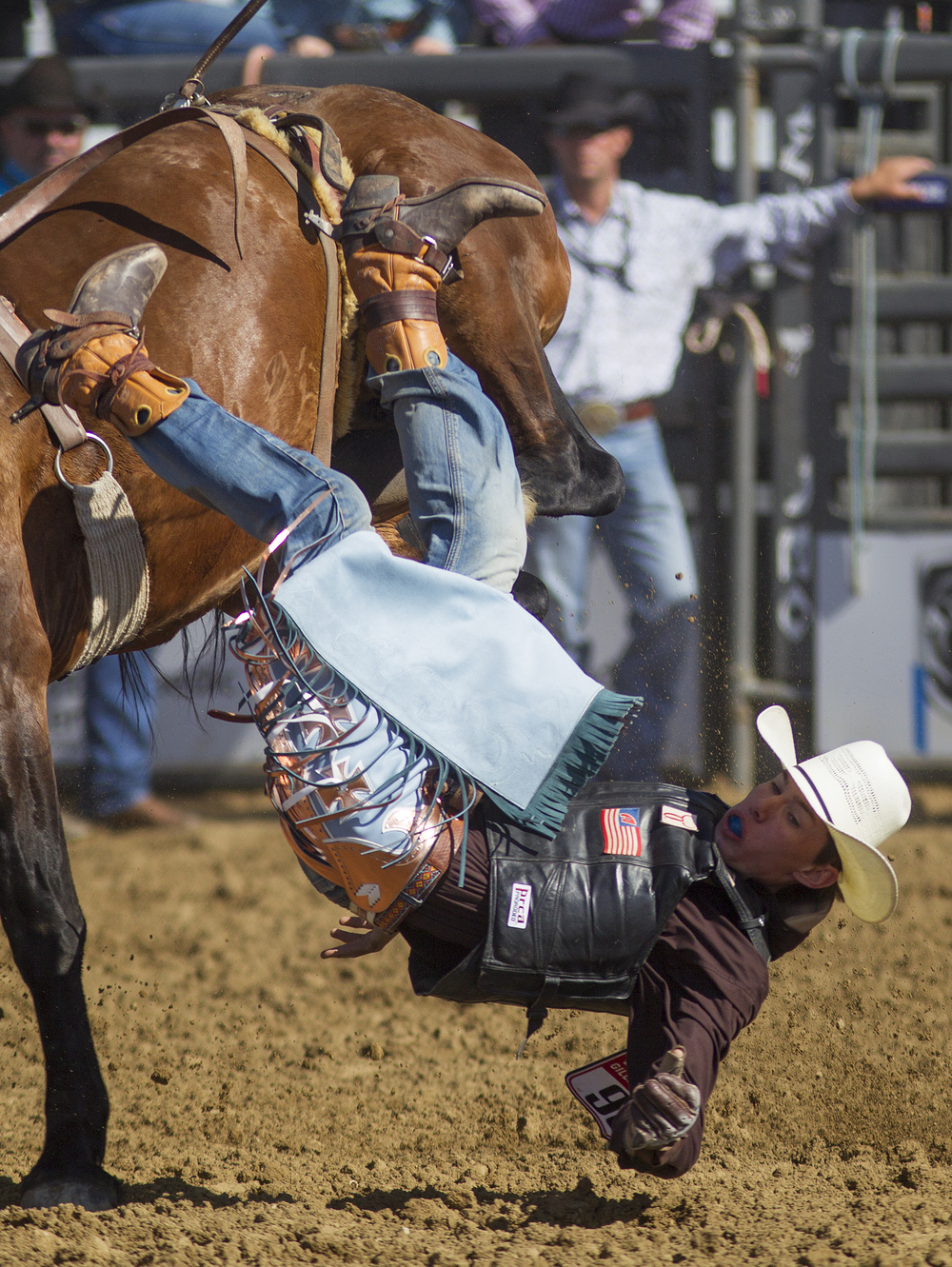 Wheatland cowboy Tyler Erickson is bucked from his horse Monday morning during the second performance of the National High School Finals Rodeo at Morningside Park.