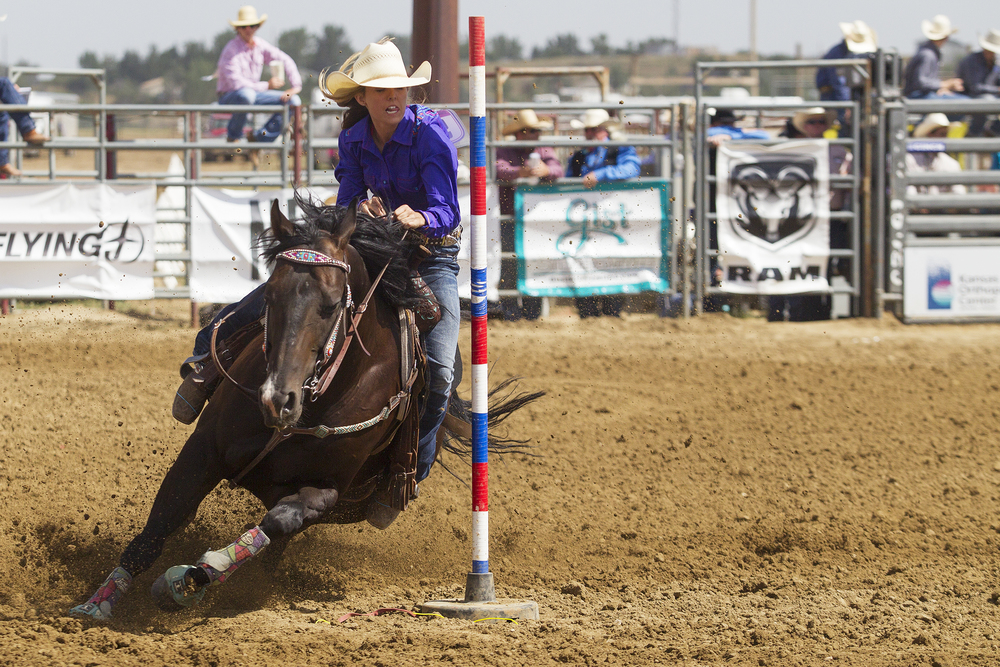 Big Piney's Karson Bradley runs the pole bending course during the second performance of the National High School Finals Rodeo Monday morning at Morningside Park.