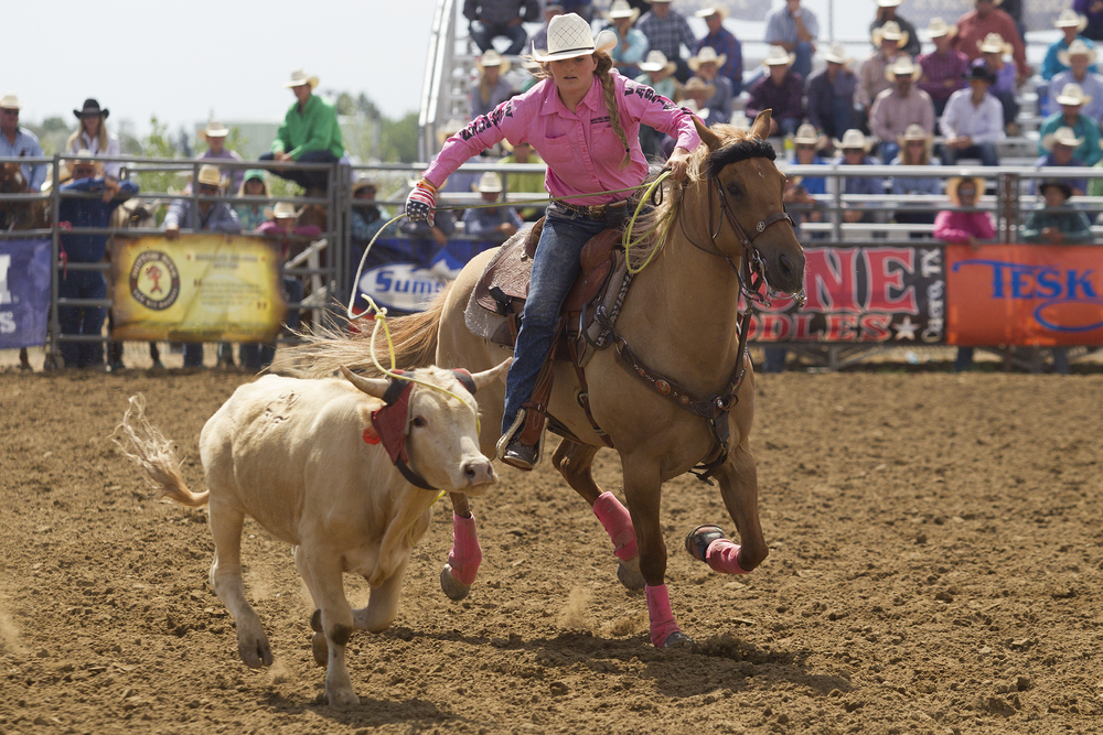 Kayden Beaver competes in team roping Monday morning during the second performance of the National High School Finals Rodeo at Morningside Park.