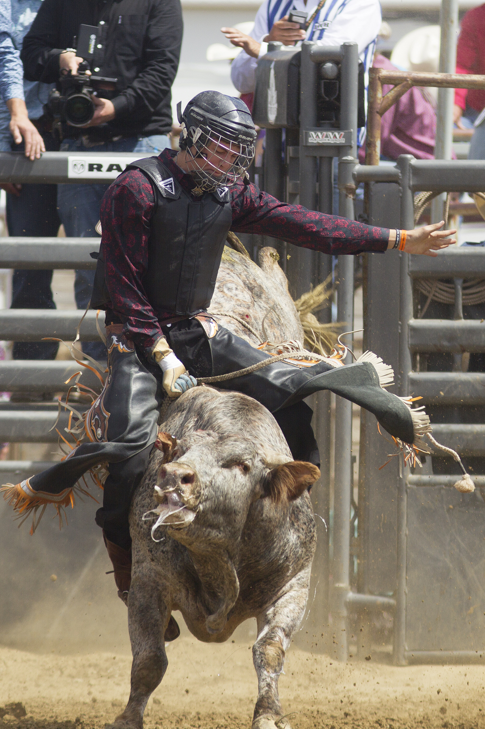 Bullrider Arles Hernandez of Clifton, Colo., holds on Monday morning during the second performance of the National High School Finals Rodeo at Morningside Park.