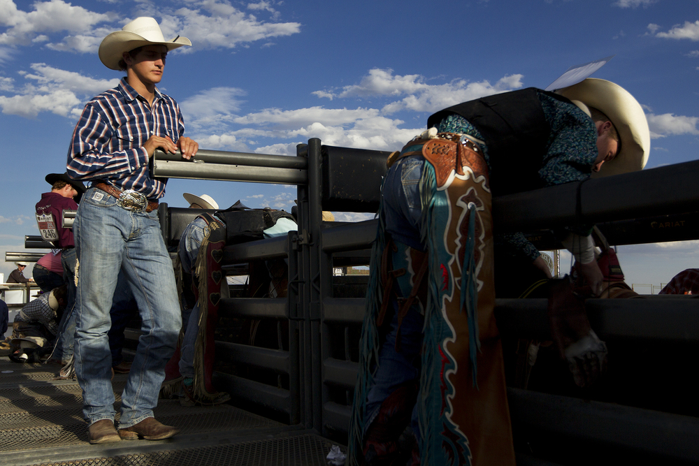 Brian Brown of La Barge leans against the chutes in the roughstock arena at Morningside Park before the evening performance on Thursday.