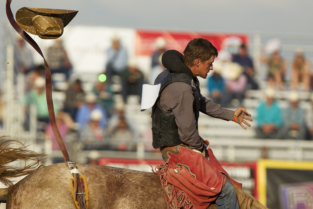 Cooper Bennett of Roosevelt, Utah, loses his hat Friday evening during the ninth performance of the 2016 National High School Finals Rodeo at Morningside Park.