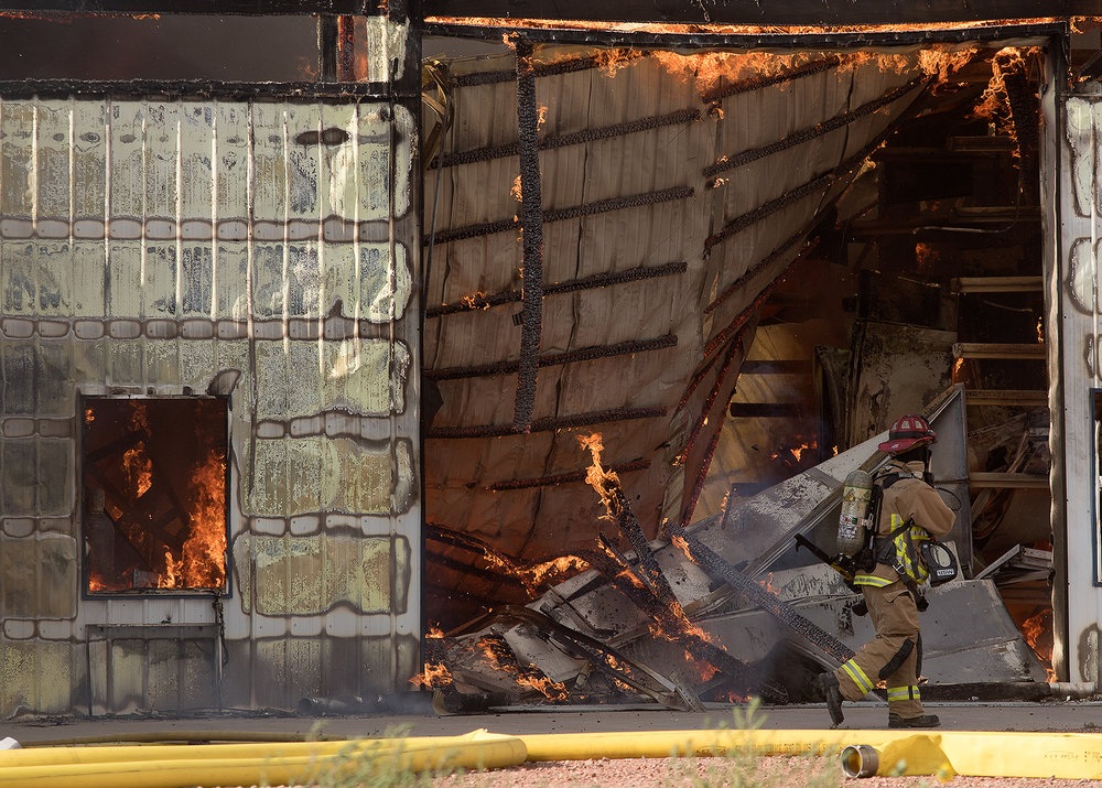 Campbell County Firefighters work to put out a blaze that destroyed a building at Curry Garage Door on Southern Drive Tuesday evening.