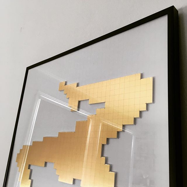 This one hasn't been out for a while.  Hand cut satin gold pixels.