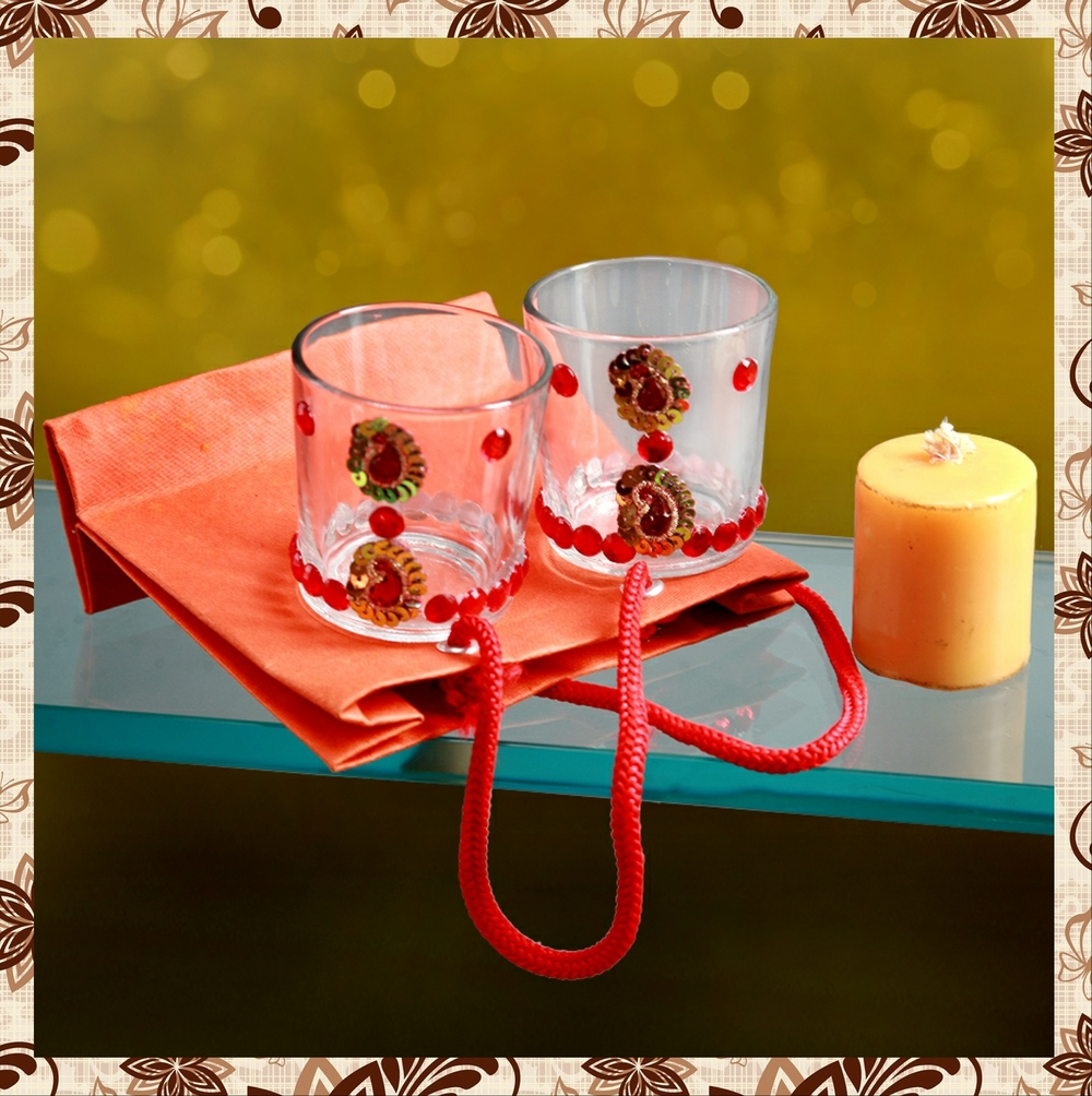 G104H15 : Pair Rs 150. Packing in paper bag. Single candle included.Special packaging at extra cost. Delivery free in Mumbai for billing value greater than Rs 2000. For bulk order rate please email mousumii@goshopart.com