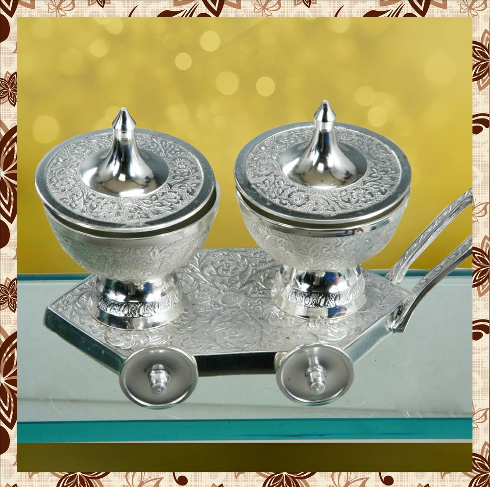 Product code:M1058: Silver polish trolley mounted containerfor dry fruits.Red velvet box.Rs 2250 plus tax.For bulk order rate email mousumii@goshopart.com