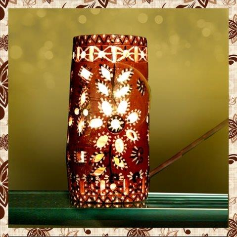 E1095H : Single Rs 500. Earthen Hand painted table lamp.Packing in bubble wrap. Special packaging at extra cost. Delivery free in Mumbai for billing value greater than Rs 2000. For bulk order rate please email mousumii@goshopart.com