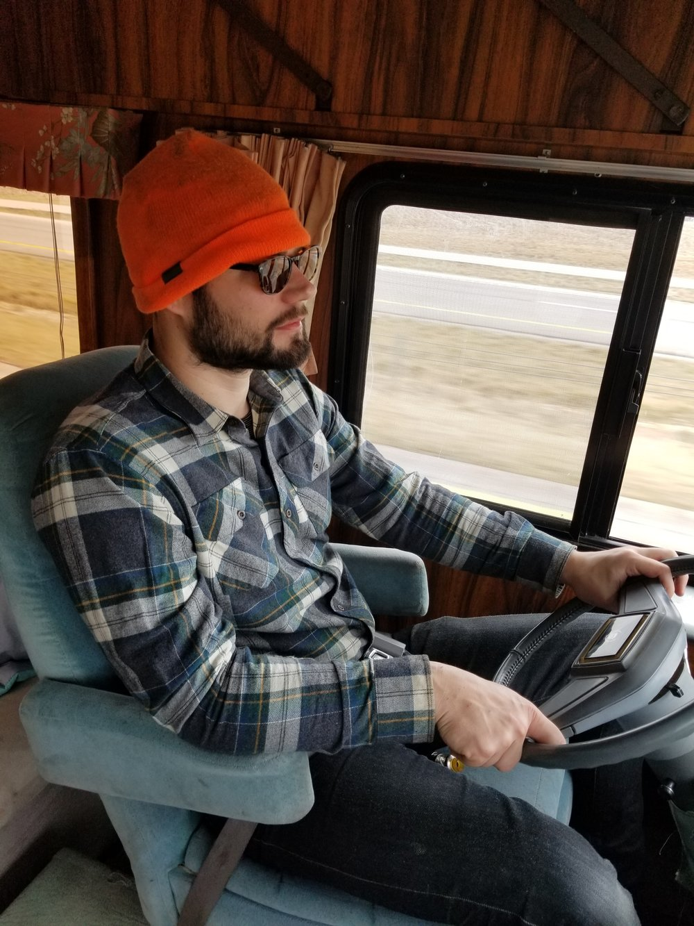 A fully cultivated long-haul look, complete with grease-stained blaze orange cap.