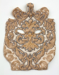 Rachel Frank     Curly Mask,    2013   Glass Beading, Upholstery Fabric   18 x 13.5 in    $800