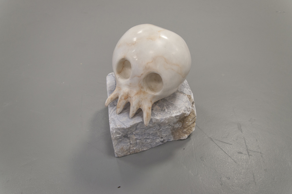 Catalina Ouyang Skull of the White Bone Demon on alabaster rock Extruded polystyrene, gypsum, pastel, varnish, alabaster 9 x 7 x 7""