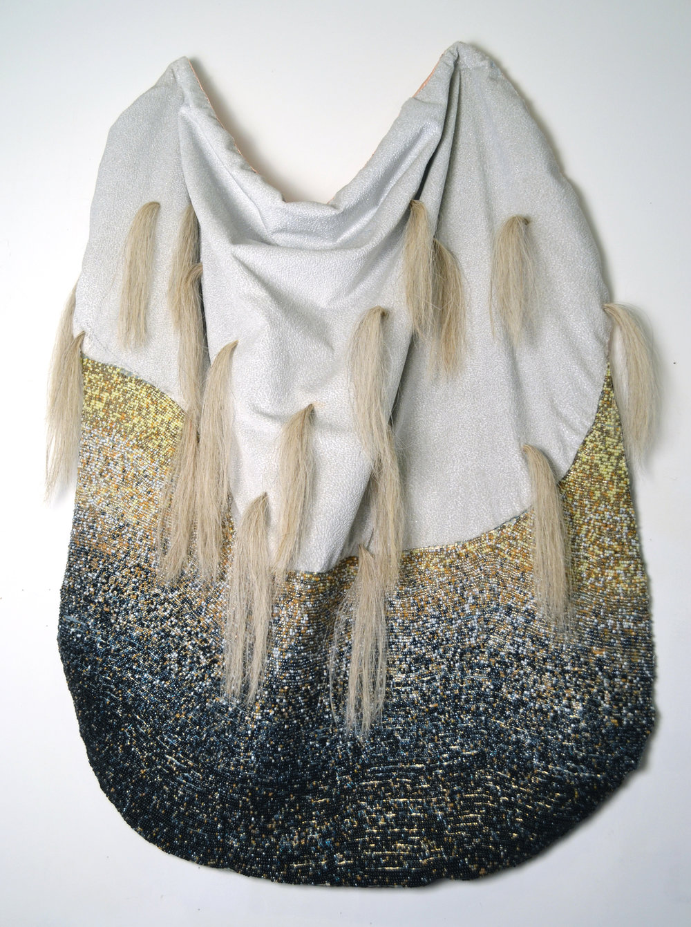 Protective Cape , 2014, Fabric, thread, glass beads, and horsehair, 48.5 x 34 x 6""