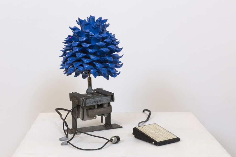 "Carolanne Patterson   |   carolannepatterson@gmail.com Blue, 2016, California pine cone, spray paint, motor, steel, foot pedal, 10"" x 8"" Value: Optimization Currency: Generosity Nomadic Pinecone. As a seed, this work must pollinate and move around. Possession coupled with generosity will increase its value. If you want this piece, you must be willing to give it away for five years (or longer). Eventually you will get it back. A commitment to this agreement, along with a travel diary of its whereabouts is required. This work must travel each year to a new home, for five years. The first year it lives with you, then you will find it a second temporary home. That person then does the same. You do not need to know the other participants. After five years it will come back to you. You can choose to keep it moving or have it for yourself permanently after this journey. Documentation of the pinecone's excursion, a simple travel diary, is a way for you (and me) to learn about the people and places that will have the piece for the years it is not in your possession. This is an experiment in movement and the unlikely concept of increasing value by sharing - in this case artwork, usually a very subjective personal purchase. By working together, many people will participate in the experiment of this value exchange. The pinecone's performance in each of its residences fulfills the value of its movement, since it has to be activated by a human to turn the motor, to stay in motion. Increasing human involvement in the realization of this exchange is what interests me most."