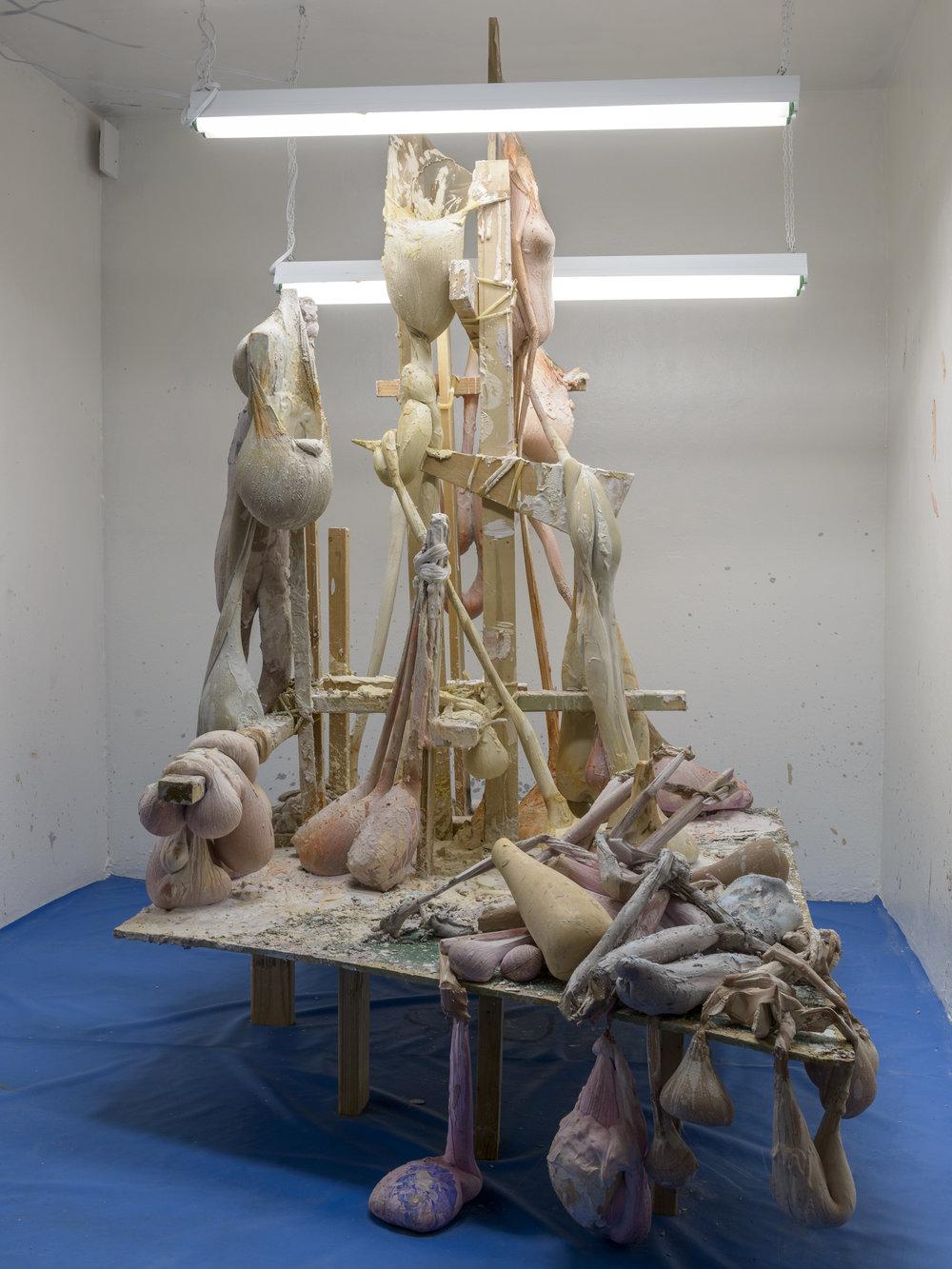 """Kayley Berezney, """"LUMPY, DUMPY, & GRUMPY"""" / 2017 / plaster, nylon, surgical tubing, found wood, florescent lighting/ 48"""" x 60"""" x 84""""   http://www.kayleyberezney.com"""