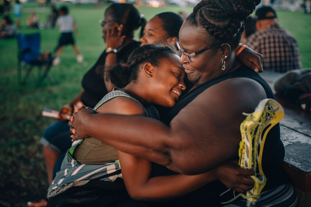 Anaya hugs her mom Quionne after scoring her first goal in lacrosse in Compton, California - 2018