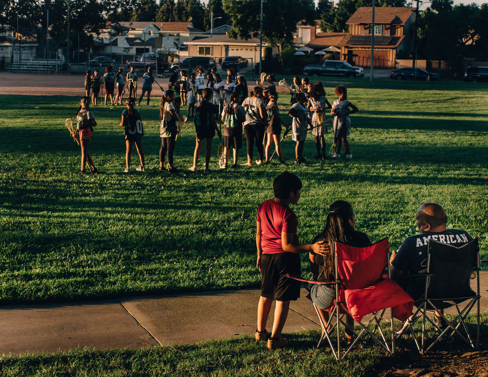 Family's came out to watch their children play lacrosse in Compton, California - 2018