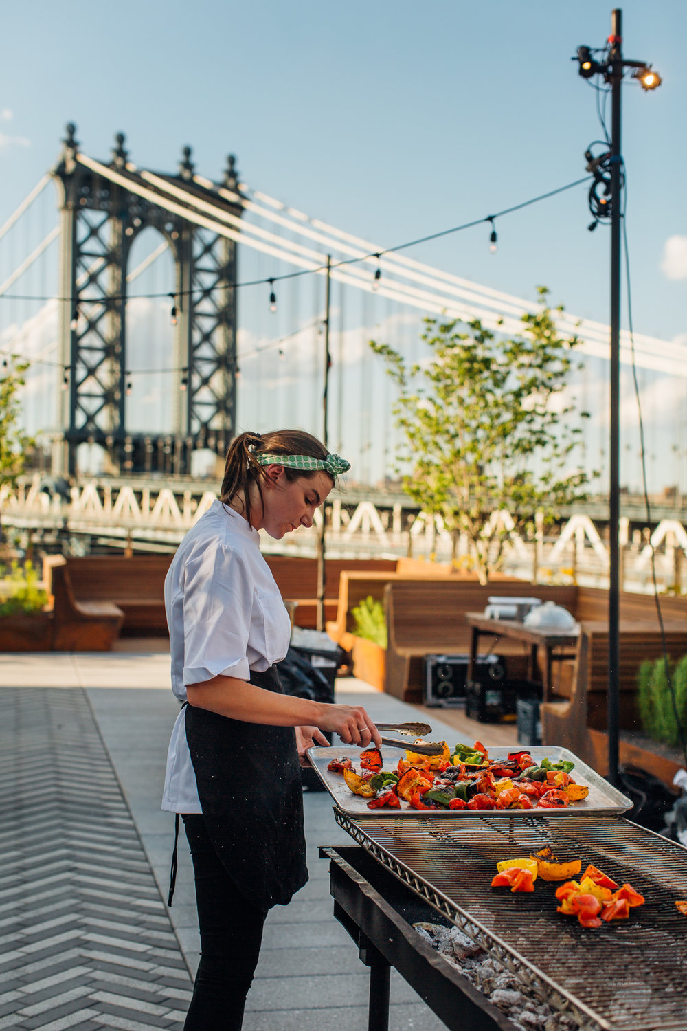 Chef Katelyn Shannon prepares vegetables during sweetgreen's launch in Brooklyn, New York on June 20, 2017.