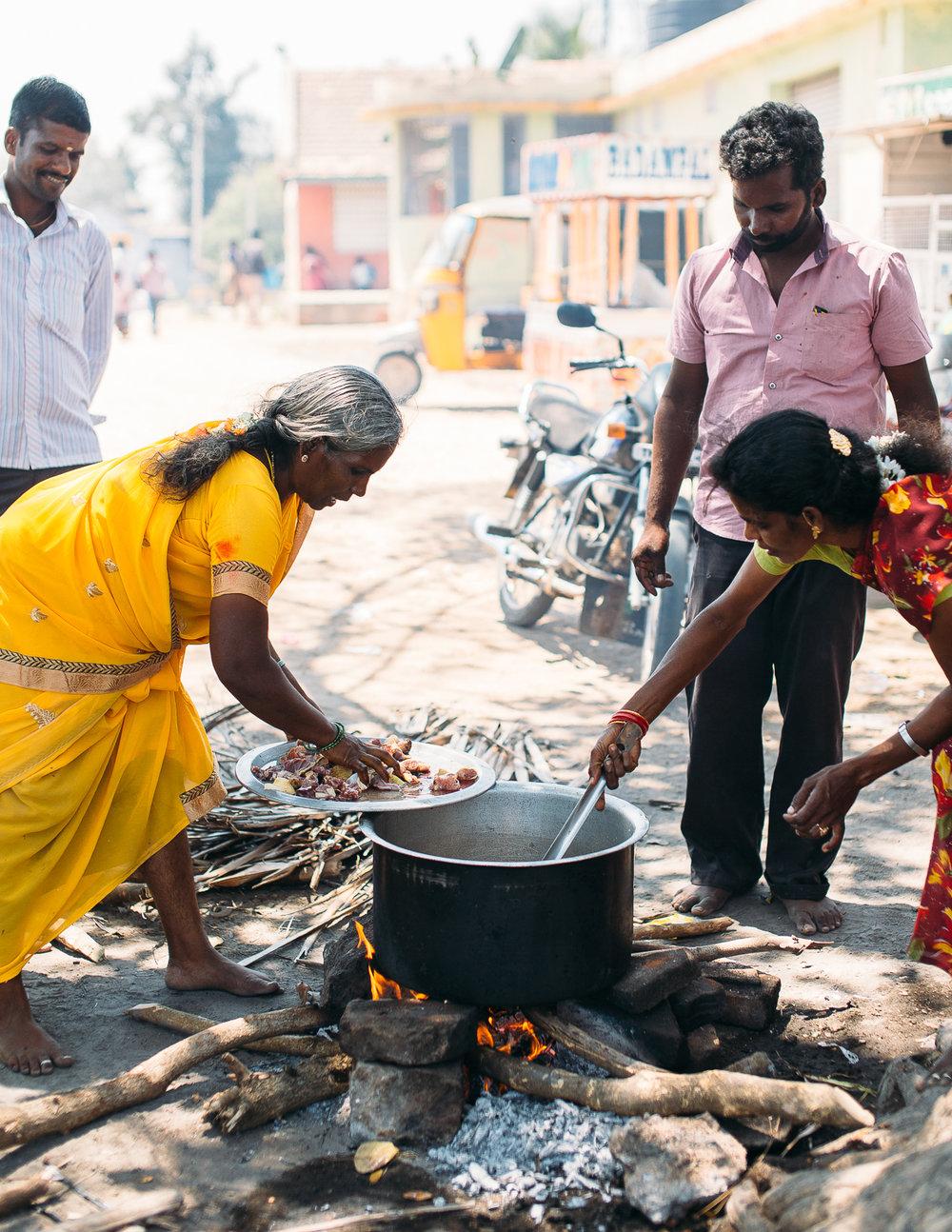 Families prepare meals in Vettuvanam, India on March 11, 2016.