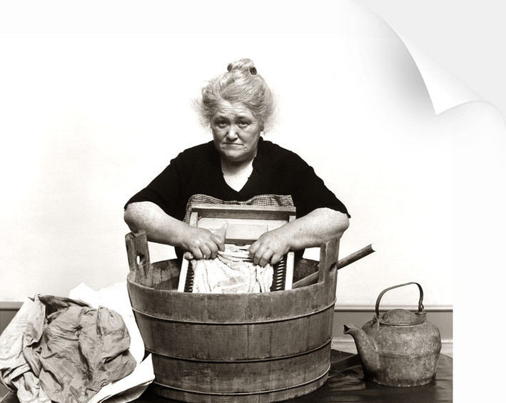 Woman Washing Clothes In Old Fashioned Wooden Tub And Washboard in 1930s