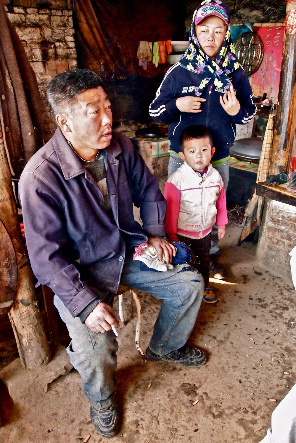 Liang Xi Quan (left) in his home in Qinglongshan, Heilongjian province, China. (C) Remko Tanis