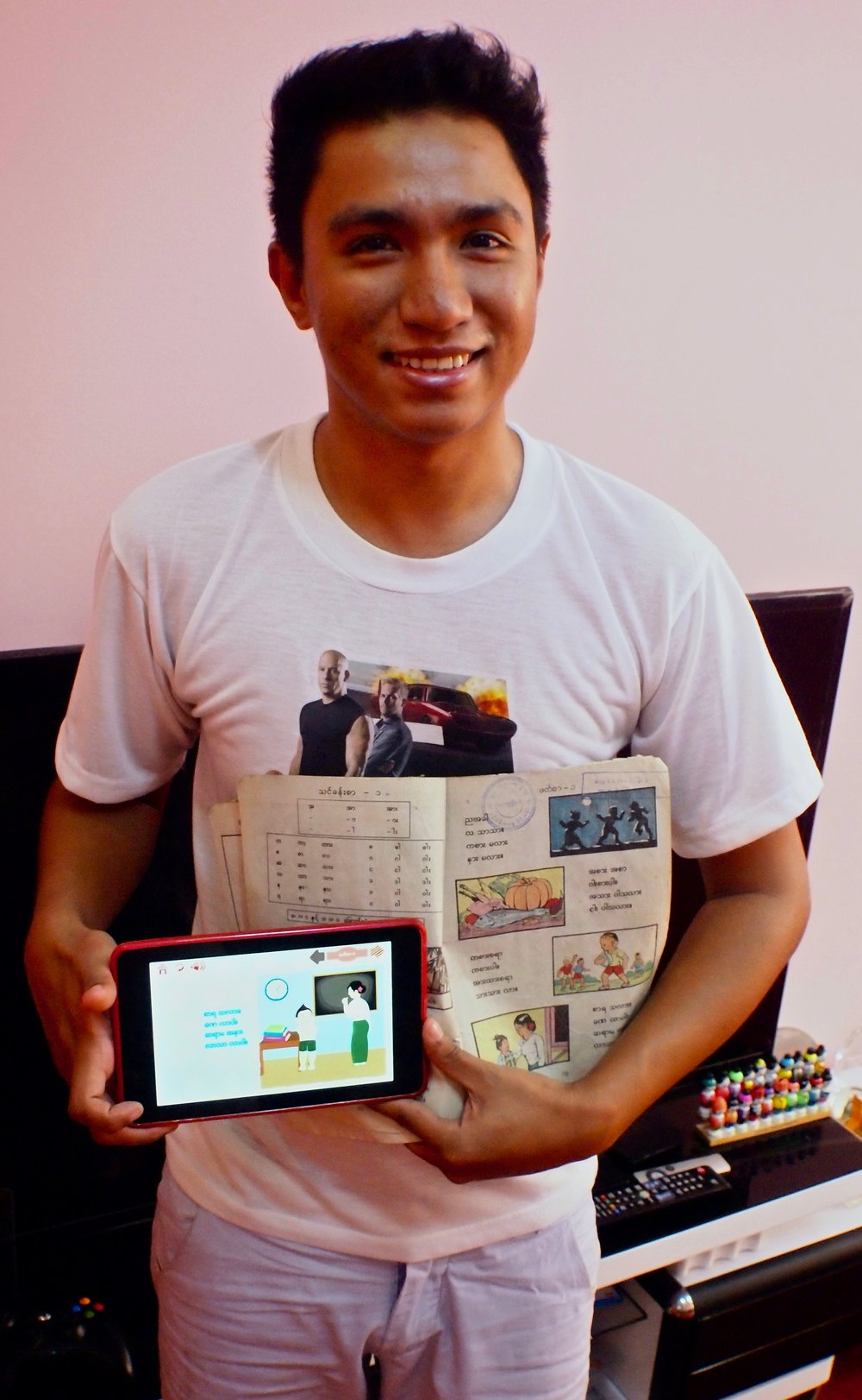Thet Naing Swe builds educational apps based on traditional school books for working Birmese children. (C) Remko Tanis